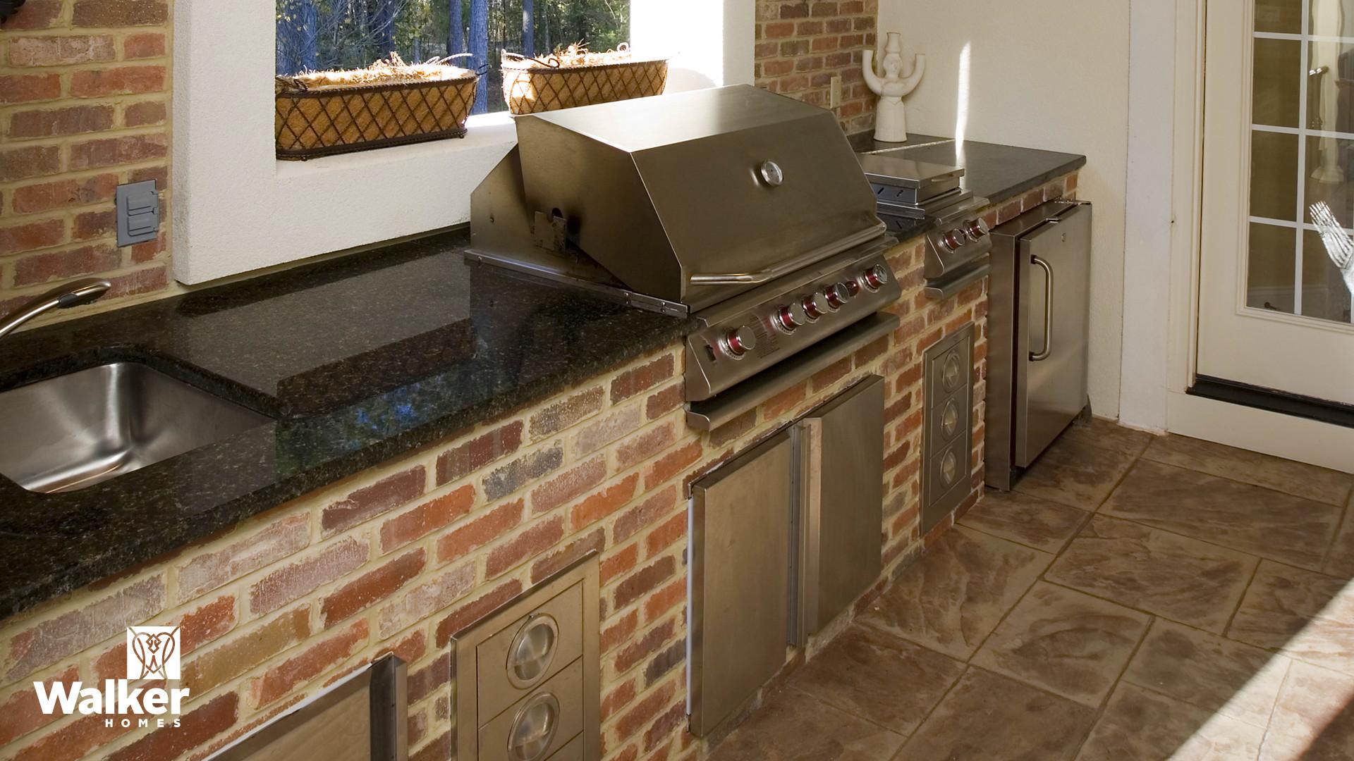 An Outdoor Kitchen from a custom home design by Walker Homes in Glen Allen, Virginia