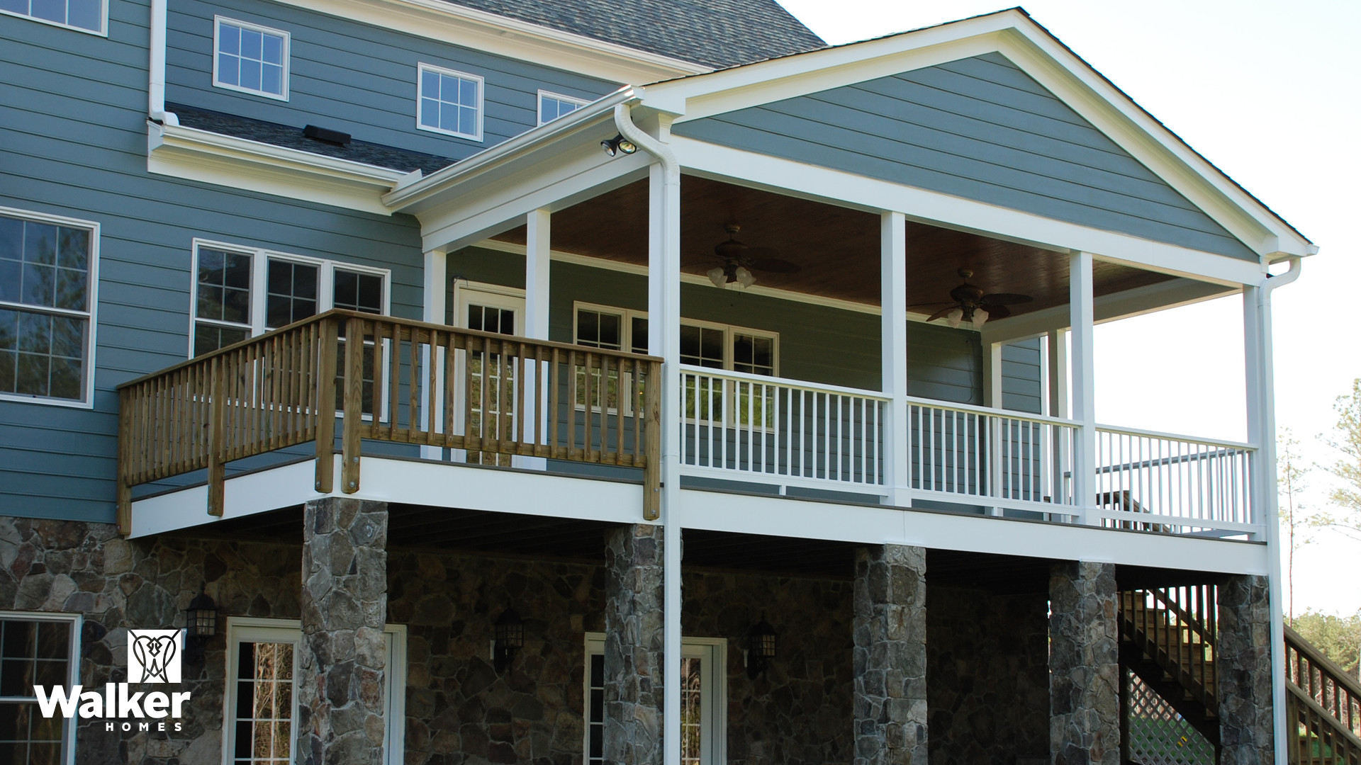 A Covered Porch and Deck from a custom home design by Walker Homes in Glen Allen, Virginia