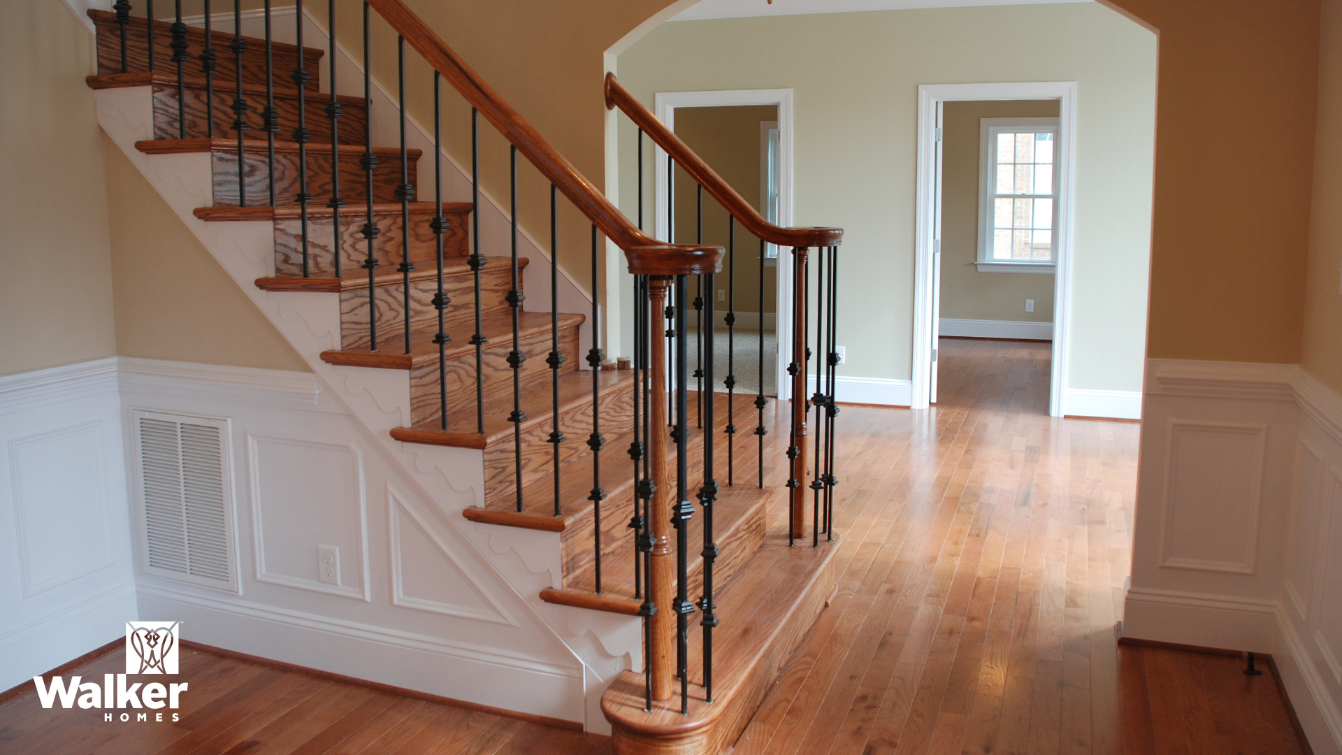 A Foyer and staircase from a custom home design by Walker Homes in Glen Allen, Virginia